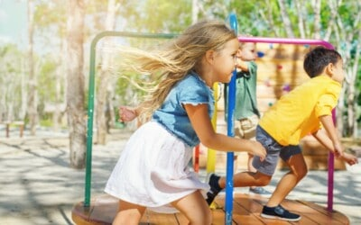 happy-little-girl-with-friends-running-around-the-carousel-in-kids-playground-summer-holidays-and_t20_azbgep
